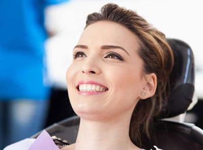 female in dental chair