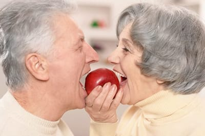 seniors eating an apple