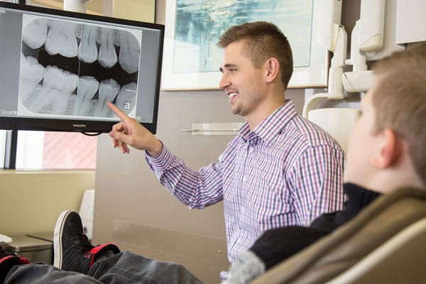 grande prairie dentist looking at xrays